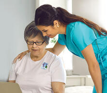 woman_given_elequil_with_nurse